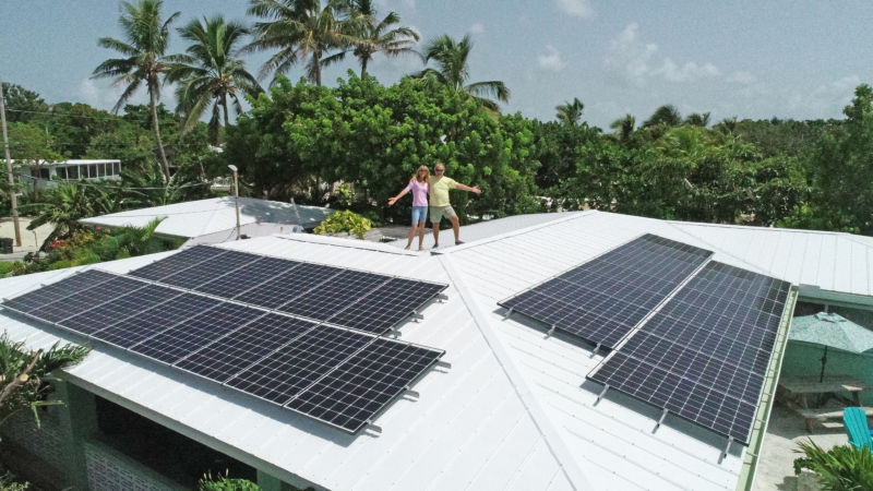 FKEC Members standing on roof with their solar array