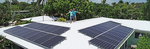 Florida Keys Electric Co-op members Linda and Mark proudly stand with their new 9,000-watt solar array.